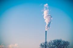Smoke of pipe in winter sky Stock Image