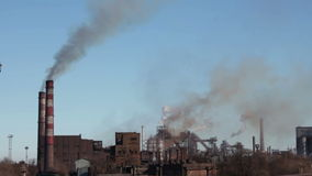 Smoke from Pipes of the Industrial Plant in the City. Industrial, metallurgical plant in the city working at full power and throws into the atmosphere of toxic stock footage