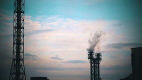 Smoke from Pipes of the Industrial Plant in the City. stock footage