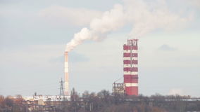 Smoke from Pipes of the Industrial Plant in the stock footage