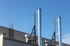 Smoke pipes on rooftop Royalty Free Stock Image