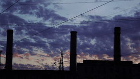 Smoke from pipes at sunset stock video footage