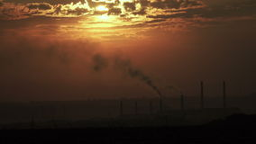 Smoke from pipes at sunset. Thermal power station and smoke from chimneys at sunset stock footage