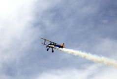 Smoke from a plane during acrobatic manoeuvres Stock Image