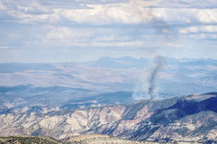 Smoke plume from controlled forest burn. In White RIver National Forest, Rocky Mountains, Colorado royalty free stock photo