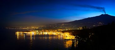 Smoke plume from Mount Etna after Sunset and Catania, Taormina and other coast towns, Sicily, Italy Stock Photography