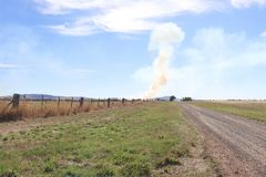 Smoke from a controlled burn-off in rural Australia. Smoke plumes from a controlled burn-off in rural Australia stock image