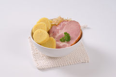 Smoke pork with potato dumplings and sauerkraut Stock Photo