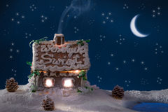 Smoke poured out of the gingerbread home at night Royalty Free Stock Photos