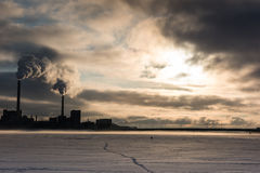Smoke from the power plant chimneys Stock Photography