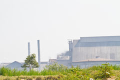 Smoke produced by the smokestacks of paper mill Stock Photo