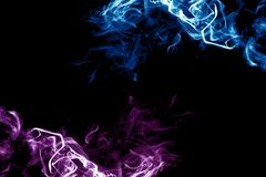 Smoke purple and blue on a dark background. stock photography
