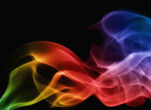 Smoke rainbow on black background Royalty Free Stock Images