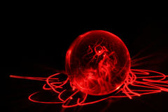 Smoke revealing the future. Gazing into the future from a magic ball filled with electricity Royalty Free Stock Images