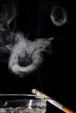 Smoke ring. With black background royalty free stock photography