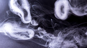 Smoke ring. Rings of smoke from electronic cigarettes Royalty Free Stock Images