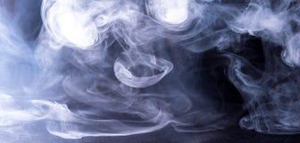 Smoke. Rings of smoke from electronic cigarettes Stock Image