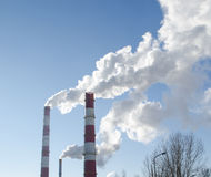Smoke rise industry factory chimneys heat blue sky Stock Photography