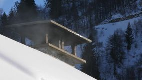 Smoking Chimney on a snowy roof stock video footage