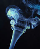 Smoke rises up Royalty Free Stock Photo