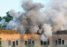 Smoke rising in the air after the explosion. Smoke rises into the air after the explosion in the early morning in the Brest Fortress. Reconstruction of battle Stock Photography