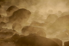 Smoke rising from hot springs . Royalty Free Stock Image