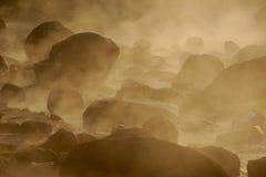 Smoke rising from hot springs . royalty free stock image