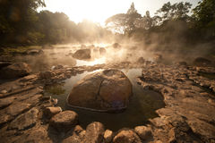 Smoke rising from hot springs in Northern of Thailand. Stock Photography