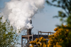 Smoke rising from industrial plant Stock Images