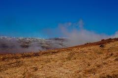 Smoke rising over grassland