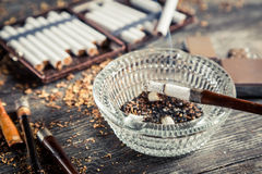 Smoke rising from a pipe in the ashtray Stock Image