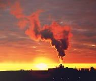 Smoke rising into the sky Stock Image