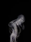 Smoke. A rising smoke trail with a black background Stock Photos