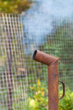Smoke from rusty pipe Royalty Free Stock Photography