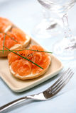 Smoke salmon with cream cheese and a dash of freshly crack black pepper Stock Images