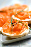 Smoke salmon on cream cheese on mini bagel Stock Image
