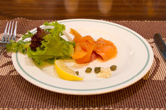 Smoke salmon on dish Stock Image