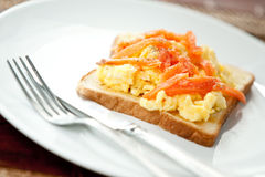 Smoke salmon with scrambled eggs on toast Royalty Free Stock Images
