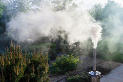 Smoke from a samovar pipe on backyard Royalty Free Stock Photography