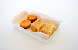 Smoke sausage in the roll bun  in a cardboard white box Stock Photography