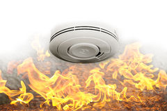 Smoke sensor and fire alarm. Concept with flames and  battery sensor gadget on the wall Stock Photos