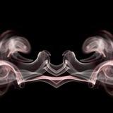 Smoke shapes. On black background Stock Photography