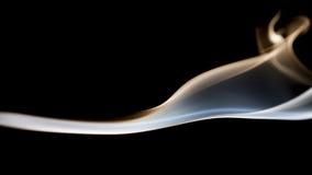 Smoke shapes on black background Royalty Free Stock Photography