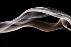 Smoke shapes on black background Royalty Free Stock Images