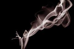 Smoke shapes on black background Royalty Free Stock Photo