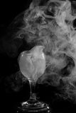 Smoke shisha in cocktail glass on a black background. Stock Photos