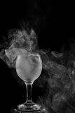 Smoke shisha in cocktail glass on a black background. Stock Images