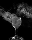 Smoke shisha in cocktail glass on a black background. Royalty Free Stock Photo