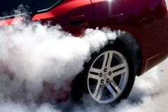 Smoke Show. A tire burning rubber royalty free stock image