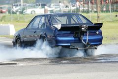 Smoke show. Picture of mustang burning rubber during drag race stock images